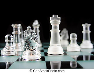 Chess - Knight Moves - Glass Chess Pieces on a Frosted Glass...