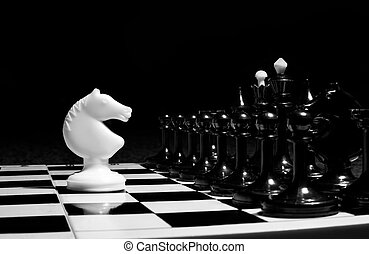 Chess knights head to head. Black and white image.