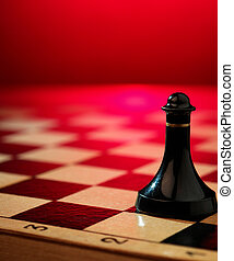 Chess on a background of a chessboard