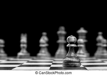 chess pawn isolated on a black background
