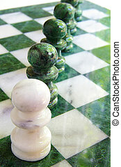 Chess pawns in a line on the board
