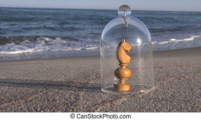 Chess piece knight on beach - Wooden handmade crude knight...
