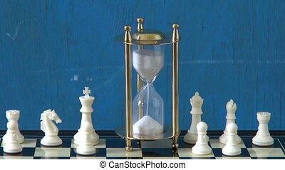 chess pieces  and hourglass