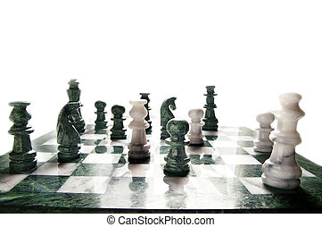 chess pieces arranged on the board, on white