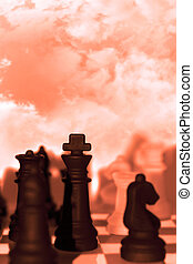 chess pieces isolated against red sky