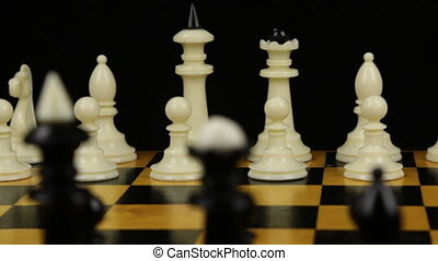 Chess pieces on a chessboard table. Panorama. Two chess ...