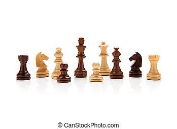 chess pieces on a white - chess pieces closeup on a white...