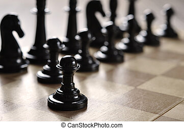 chess pieces on a wooden desk closeup