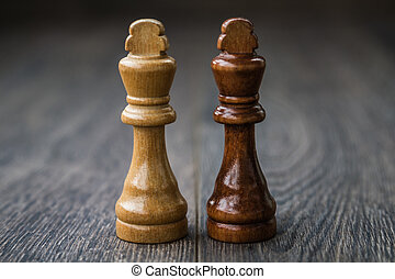 Chess Pieces on a Wooden Table