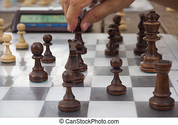 chess pieces on a wooden table closeup