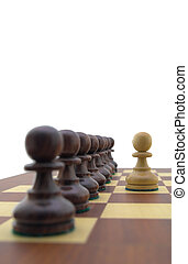 Chess pieces - white pawn in front of a row of black pawns