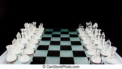 Chess - The Game is on - Glass Chess Pieces on a Frosted...