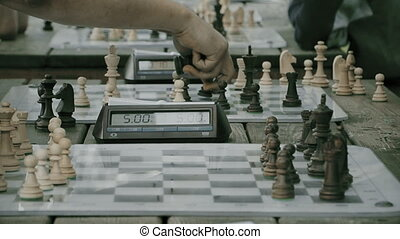 chess tournament in the Park, chess clock, summer day