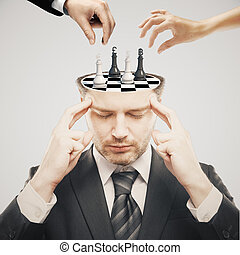 Chess tournament light - Thoughtful businessman with chess...