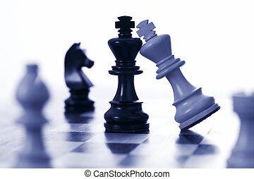 Chess white king attacks black king blue tone