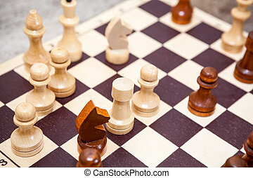 Chess wooden figures in game