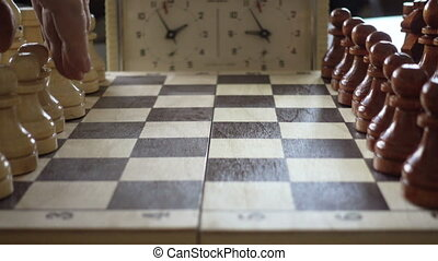 Chessboard And Chess Pieces - People Moving a Chess Pieces....