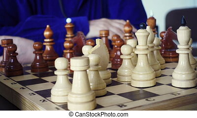 Chessboard And Chess Pieces - People Moving a Chess Pieces