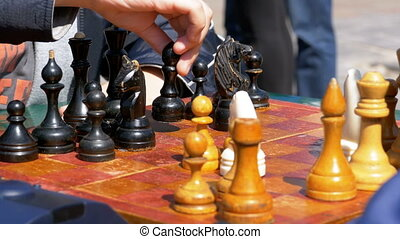 Chessboard and figures. Competitions in checkers among...