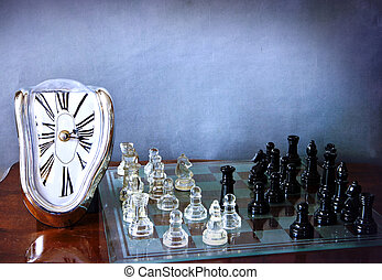 Chessboard game and Dali-like clock - A melting and...