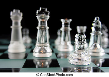 Chessgame - focus on the pawn - Glass Chess Pieces on a...