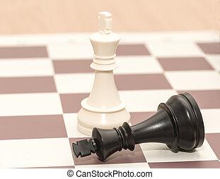 Chessmen the white king and the fallen black king