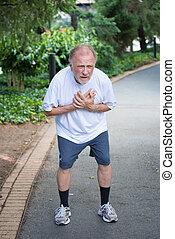 Chest pain - Closeup portrait, old man clutching chest,...