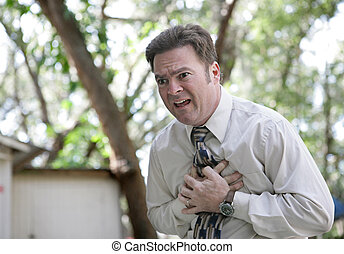 Chest Pain Outdoors - A forty year old businessman outdoors...