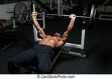 Chest Workout On Bench Press - Mature Man In Gym Exercising...