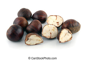 Whole and cut chestnuts on a white background