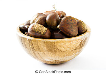Chestnuts in a bowl isolated on white background