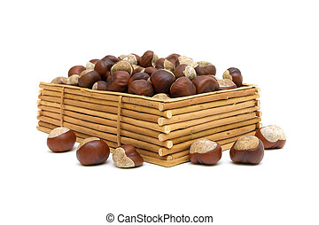 chestnuts in a wooden box isolated on white background