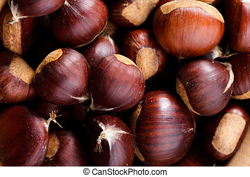 Chestnuts in wooden plate on talbe