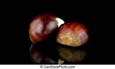Chestnuts on a black reflective bac