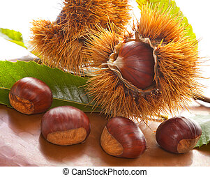 Chestnuts on table of copper