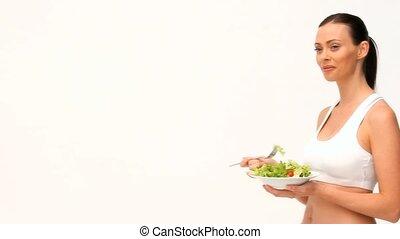 cheveux brun, femme mange, salade