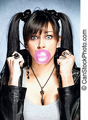 chewing gum bubble - young blue eyes woman making a big pink...