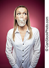 Chewing gum - Young woman making a chewing gum bubble and...