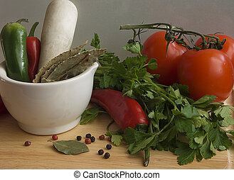 Chi Ili, tomatoes I - Chilli, spices and parsley on a wooden...