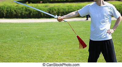 chi tai, artes marciais, atleta, perito, faz, movimentos, com, espada