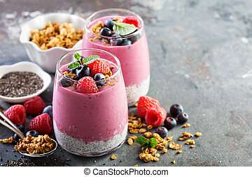 Chia pudding parfait with berry smoothie and granola