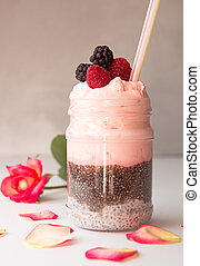 Chia pudding with berries. Overhead dessert with chia, raspberry, blueberry, strawberry and whipped cream. Healthy super food detox concept.