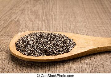 Chia Seed. Grains in wooden spoon. Rustic.
