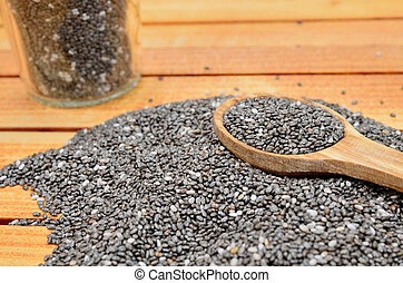chia seed with spoon on table
