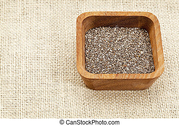chia seeds in wood bowl
