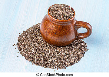 Chia seeds on a blue wooden background