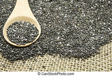 Chia seeds on wood spoon, selective focus