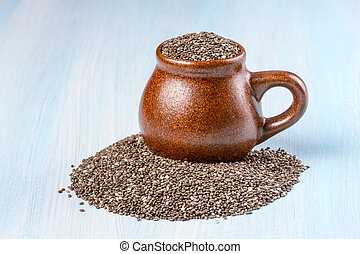 Chia seeds on wooden background