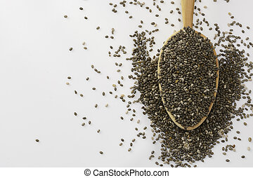 Chia seeds on wooden spoon isolated on white background