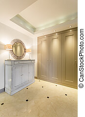 Chic dressing room with a wardrobe